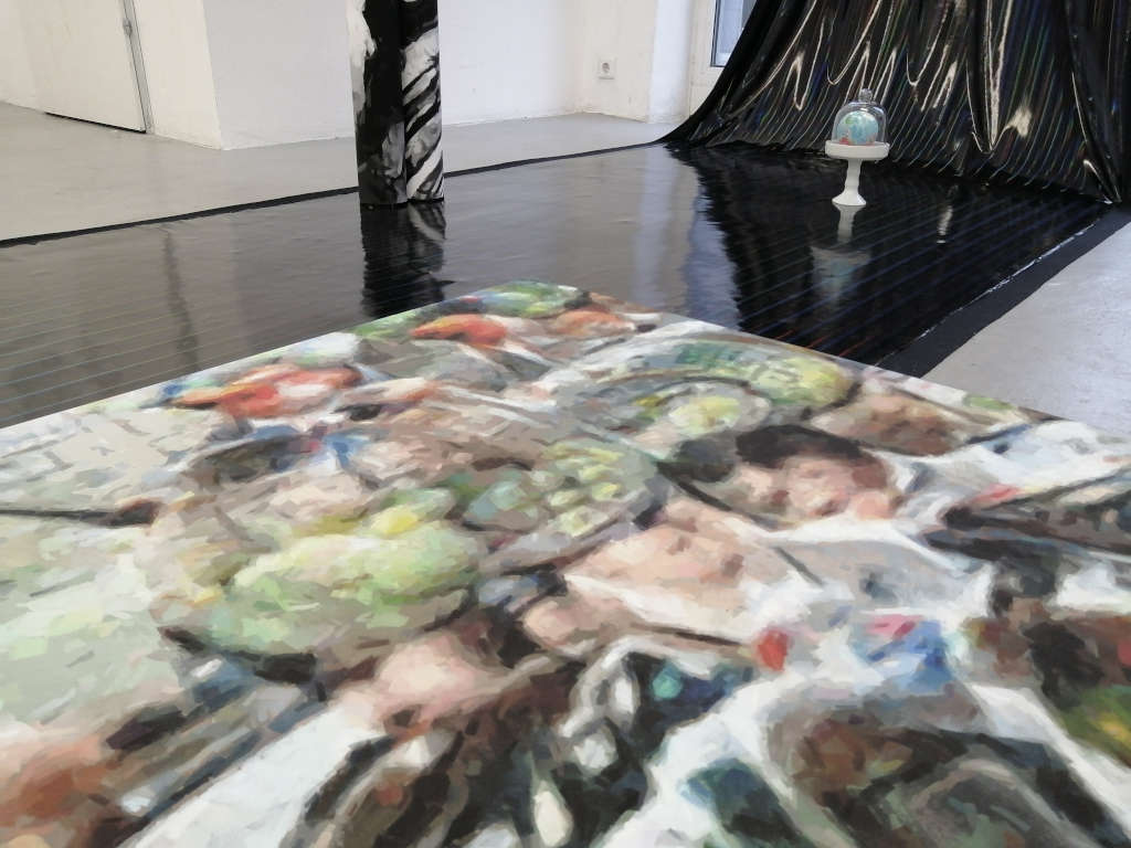 Exhibition view with works by Hidéo Snes, who teaches Artificial Intelligence how to paint.